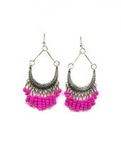 Indianen oorbellen met roze kralen