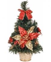 Kleine kerstboom met rode decoratie