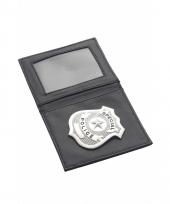 Politie badge in een mapje