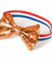 Rood wit blauw armbandje met oranje strik