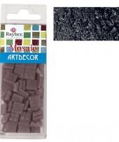 Zwarte mozaiek steentjes in doosje