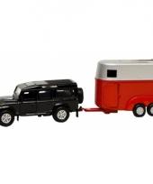 Zwarte speel auto land rover met trailer